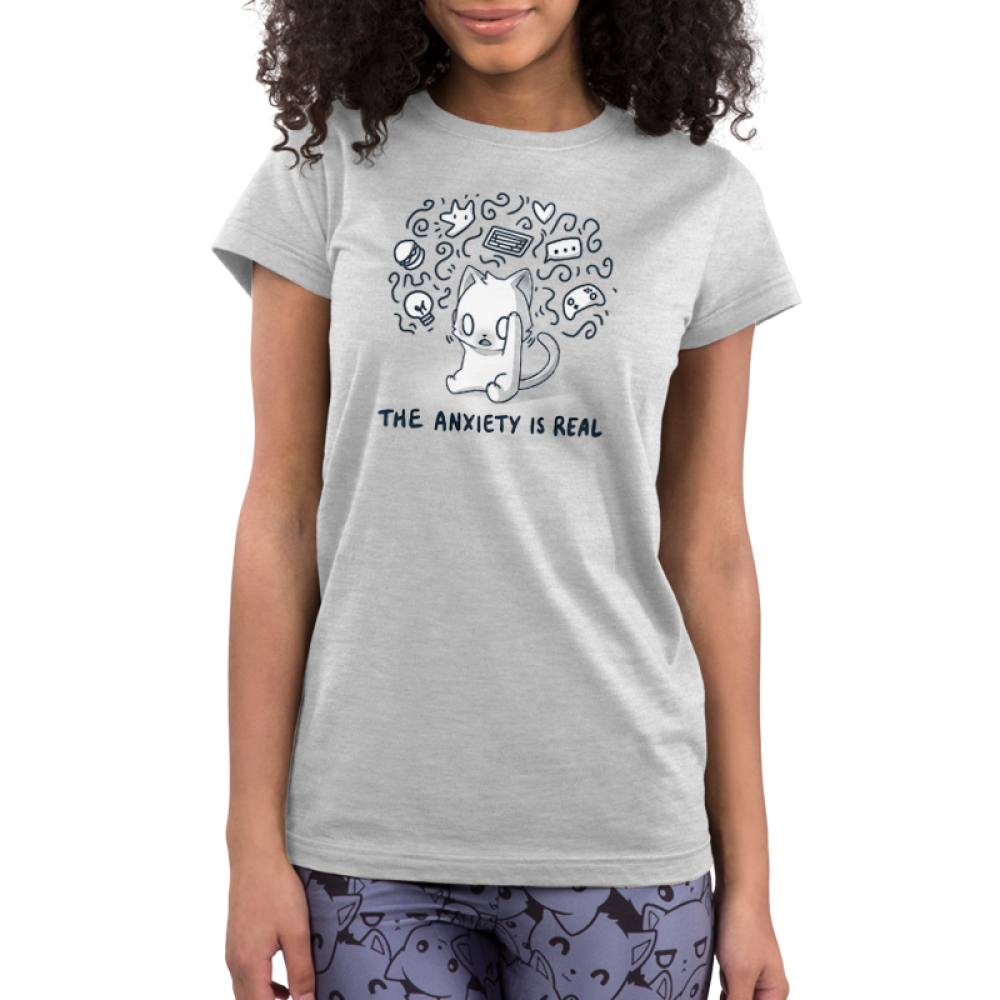 The Anxiety is Real Junior's t-shirt model TeeTurtle light gray t-shirt featuring a stressed looking wide-eyed cat holding its head with squiggles and different objects surrounding its head