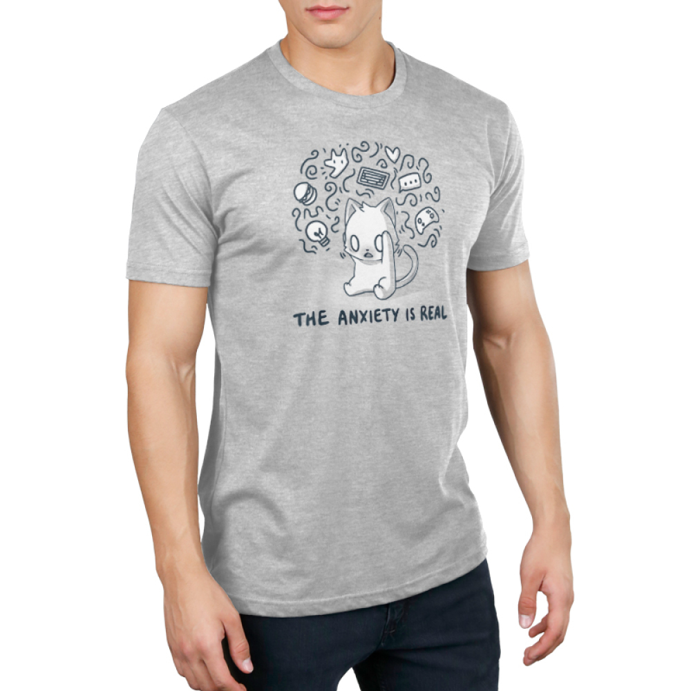The Anxiety is Real Men's t-shirt model TeeTurtle light gray t-shirt featuring a stressed looking wide-eyed cat holding its head with squiggles and different objects surrounding its head