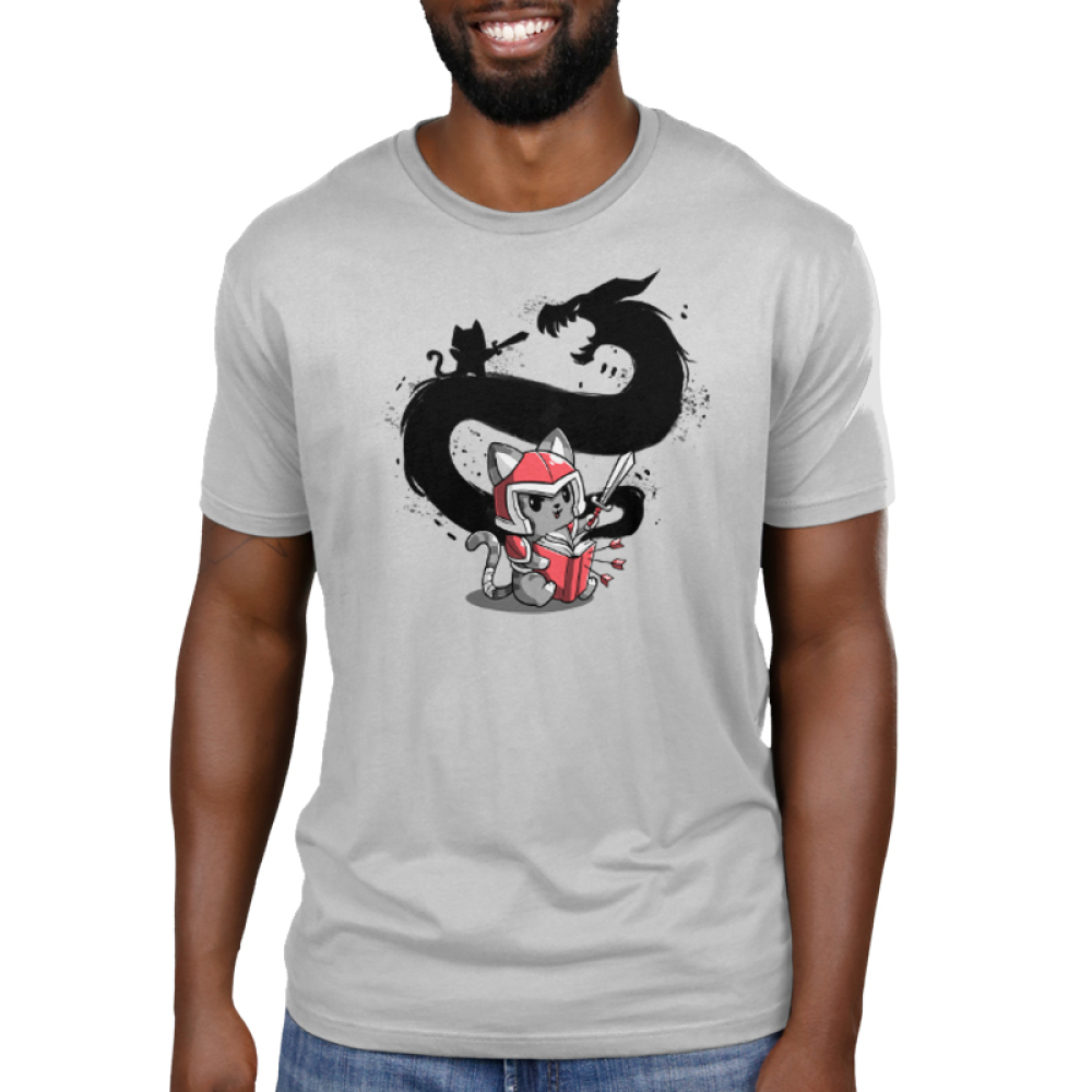 Adventure Awaits Men's t-shirt model TeeTurtle light gray t-shirt featuring a cat in a red armored suit reading a book with a sword in his hand with the shadow of himself and a dragon behind him