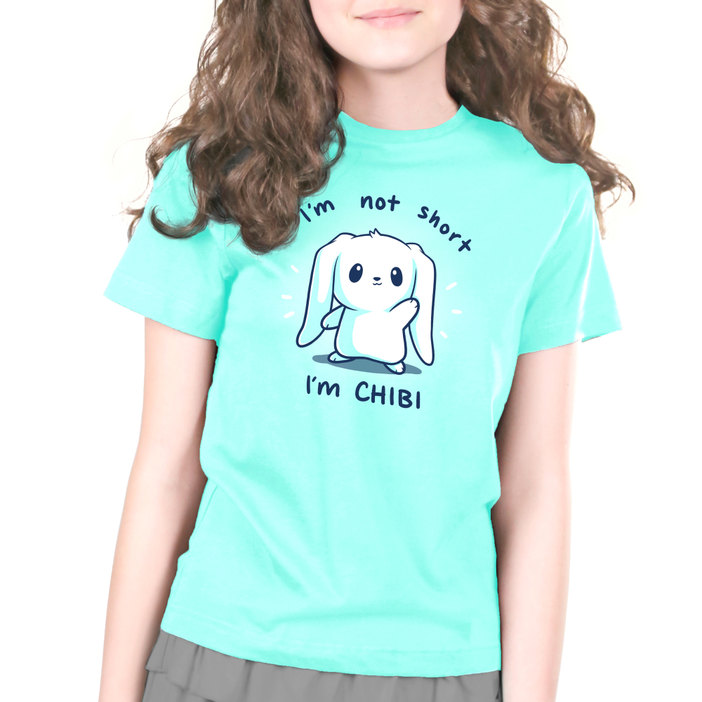 I'm Not Short, I'm Chibi! Kid's t-shirt model TeeTurtle chill blue t-shirt featuring a white bunny waving with its ears flopped over