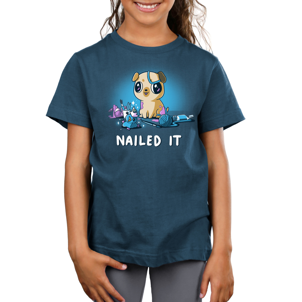 Nailed It Junior's t-shirt model TeeTurtle denim blue t-shirt featuring a pug with big eyes covered in purple paint with a mess of crafts around him