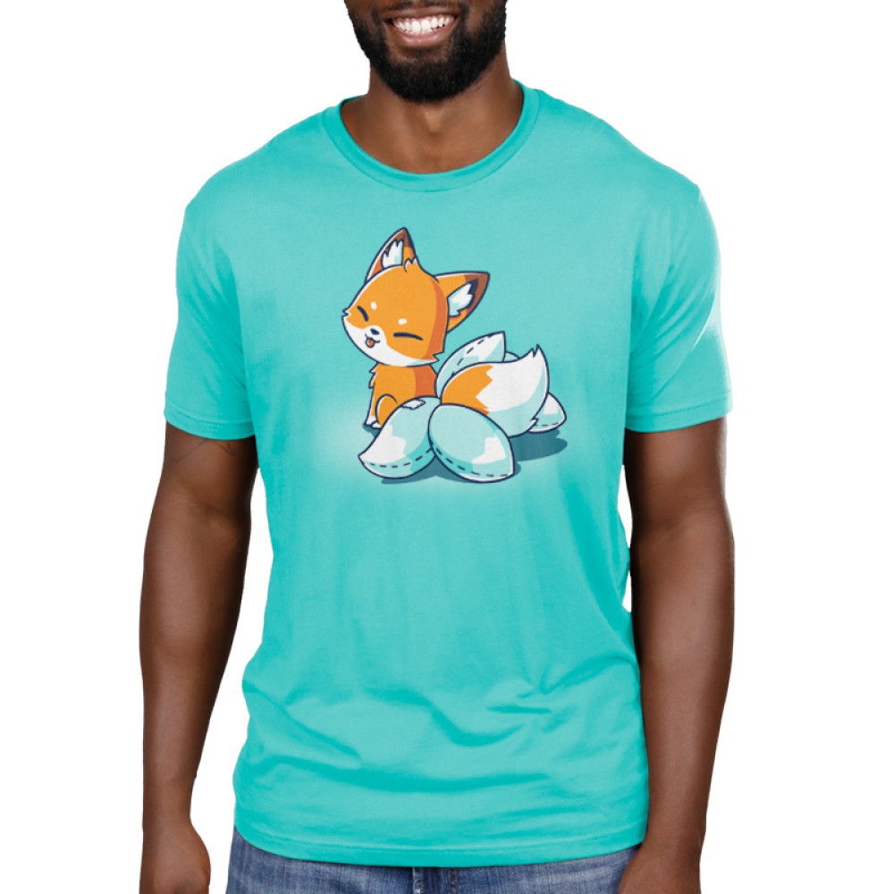 Kitsune Cosplay Men's t-shirt model TeeTurtle Caribbean blue t-shirt featuring an orange fox with white on its moth and the tip of its tail, seated, facing away and looking back at you with its tongue poking out in a playful manner. It has 4 white fake tails attached to the real tail that have dashed lines along the edges to show that they were stitched together.