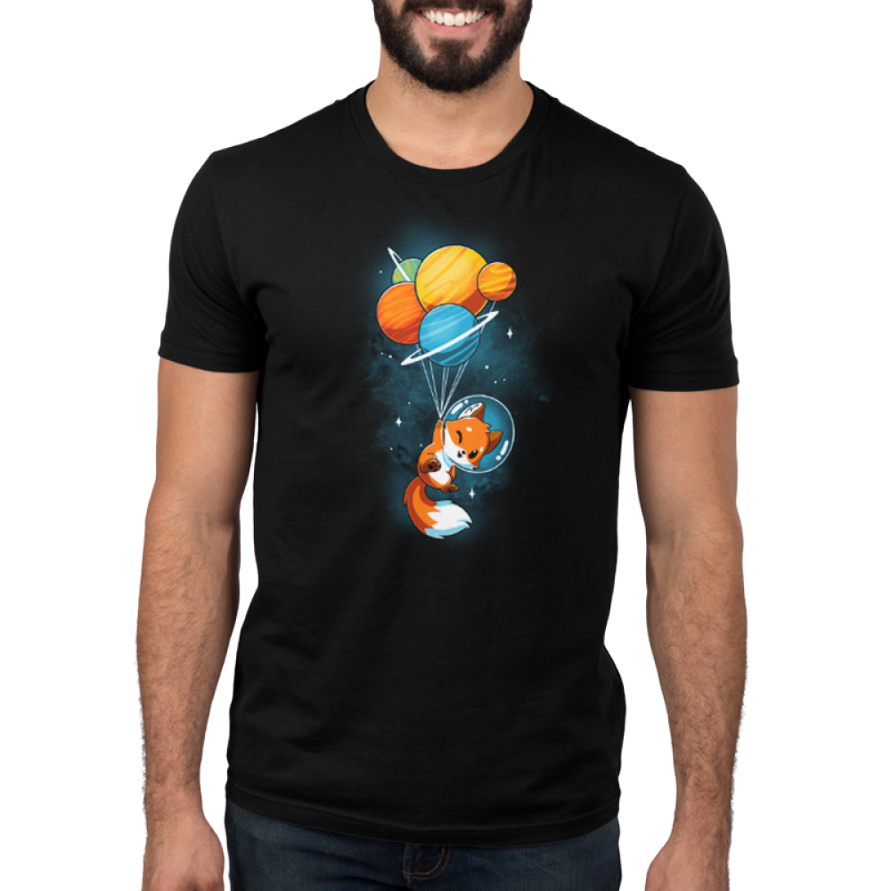 Foxy Astronaut Men's t-shirt model TeeTurtle black t-shirt featuring a fox in space with an astronaut helmet holding onto a bunch of planets tied together like balloons