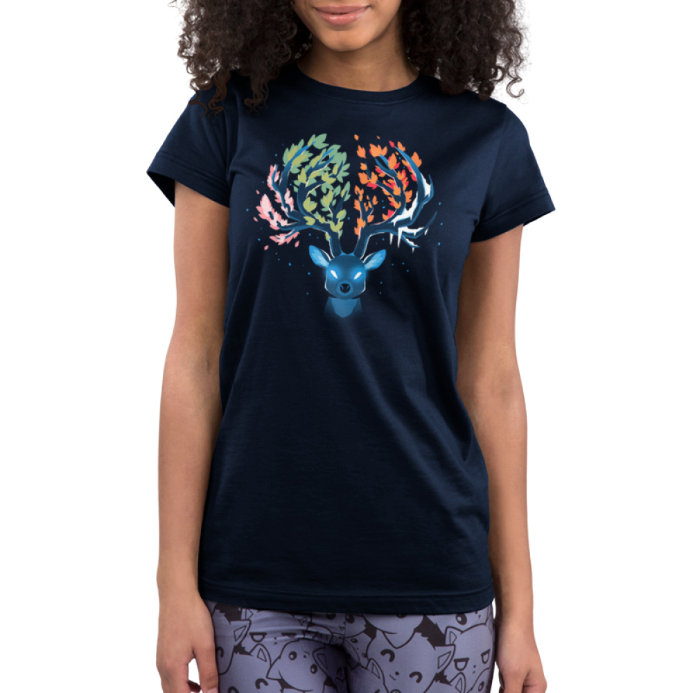 Seasonal Stag Junior's t-shirt model TeeTurtle navy t-shirt featuring a stag with pink leaves on the left of its antlers, green leaves in the middle, orange leaves in the middle, and ice on the right of its antlers