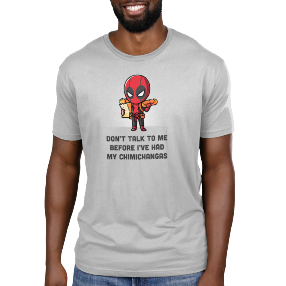 Deadpool Loves Chimichangas Men's t-shirt model officially licensed silver Marvel t-shirt featuring Deadpool holding a bad of groceries in one arm and a chimichanga in the other hand