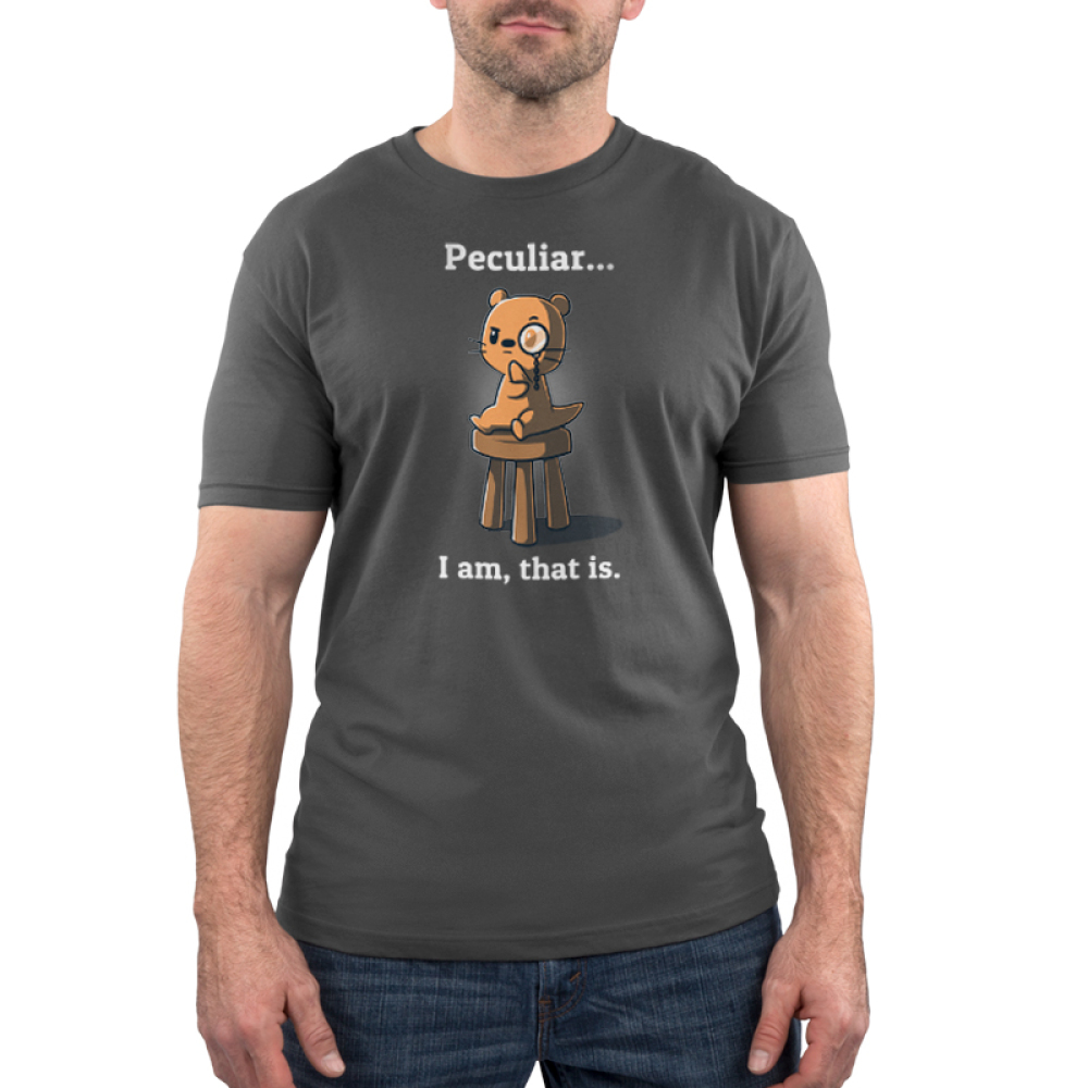 Peculiar... I Am, That Is. Men's t-shirt model TeeTurtle charcoal t-shirt featuring an otter sitting on a stool with one arm on his chin wearing a monocle