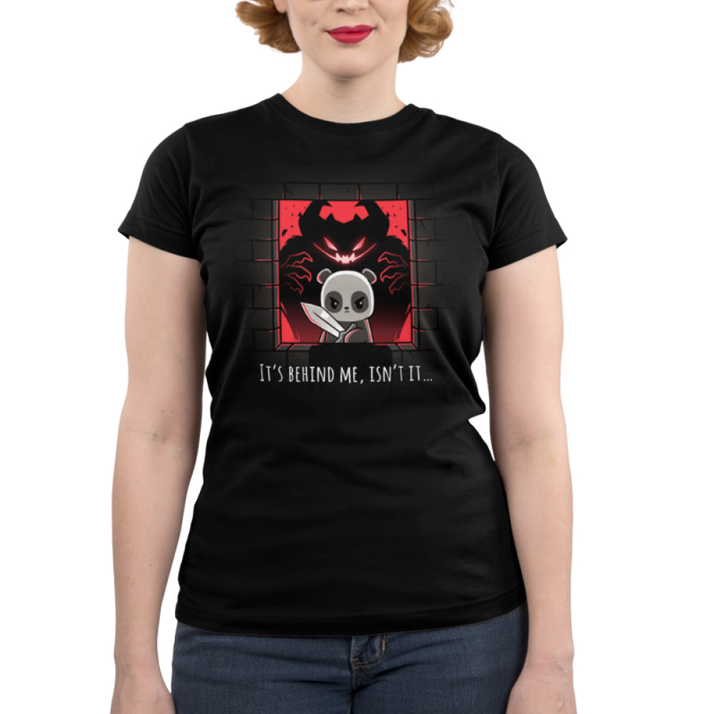 It's Behind Me, Isn't It... Junior's t-shirt model TeeTurtle black t-shirt featuring a panda in a castle window holding a sword with a black and red monster behind him