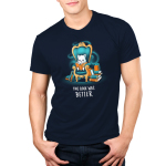 The Book Was Better (Cat) Men's t-shirt model TeeTurtle navy t-shirt featuring a white cat sitting on a big teal arm chair reading a book with stacks of books on either side of the chair