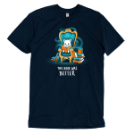 The Book Was Better (Cat) t-shirt TeeTurtle navy t-shirt featuring a white cat sitting on a big teal arm chair reading a book with stacks of books on either side of the chair