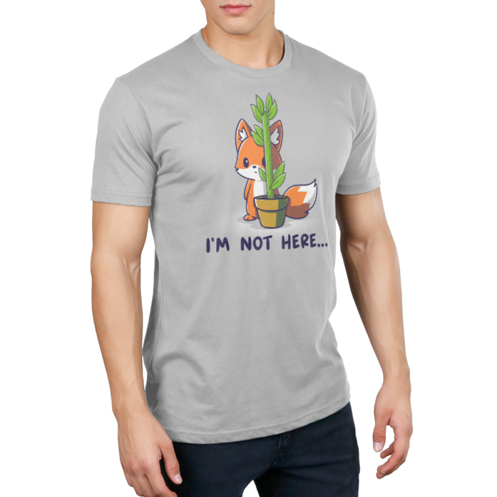 "I'm Not Here Men's t-shirt model TeeTurtle light gray t-shirt featuring an orange fox standing on its hind feet, hiding behind a potted plant that is  tall but very thin. The shirt text below the image reads ""I'm Not Here…"""