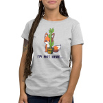 "I'm Not Here Women's t-shirt model TeeTurtle light gray t-shirt featuring an orange fox standing on its hind feet, hiding behind a potted plant that is  tall but very thin. The shirt text below the image reads ""I'm Not Here…"""