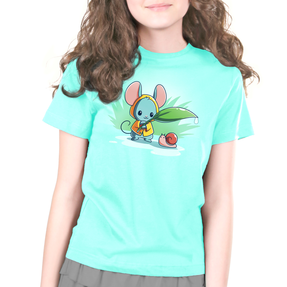 Rain Drops Kid's t-shirt model TeeTurtle chill blue t-shirt featuring a little mouse in a yellow raincoat holding a leaf with a water drop off the end over a tiny snail