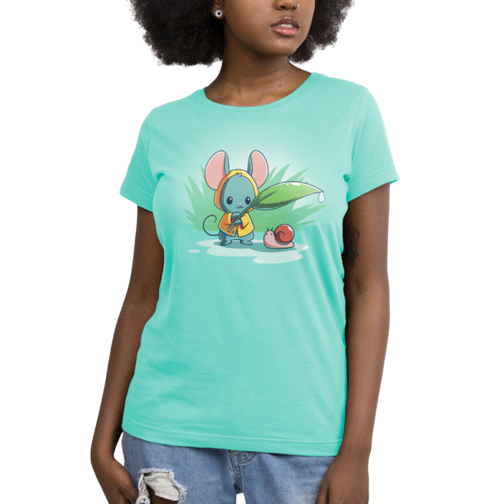 Rain Drops Women's t-shirt model TeeTurtle chill blue t-shirt featuring a little mouse in a yellow raincoat holding a leaf with a water drop off the end over a tiny snail