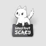 Smol but Scary pin TeeTurtle pin featuring a cat on all fours looking angry with its tail all bushy
