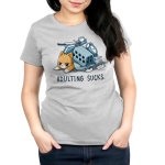 Adulting Sucks Women's t-shirt model TeeTurtle silver t-shirt featuring a tired looking cat laying down with a pile of stuff on top of him including a laundry basket, pots and pans, a clock, stack of books, and more