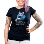 Avoiding Spoilers Junior's t-shirt model TeeTurtle navy t-shirt featuring a gray chinchilla sitting up against a blue pillow reading a book
