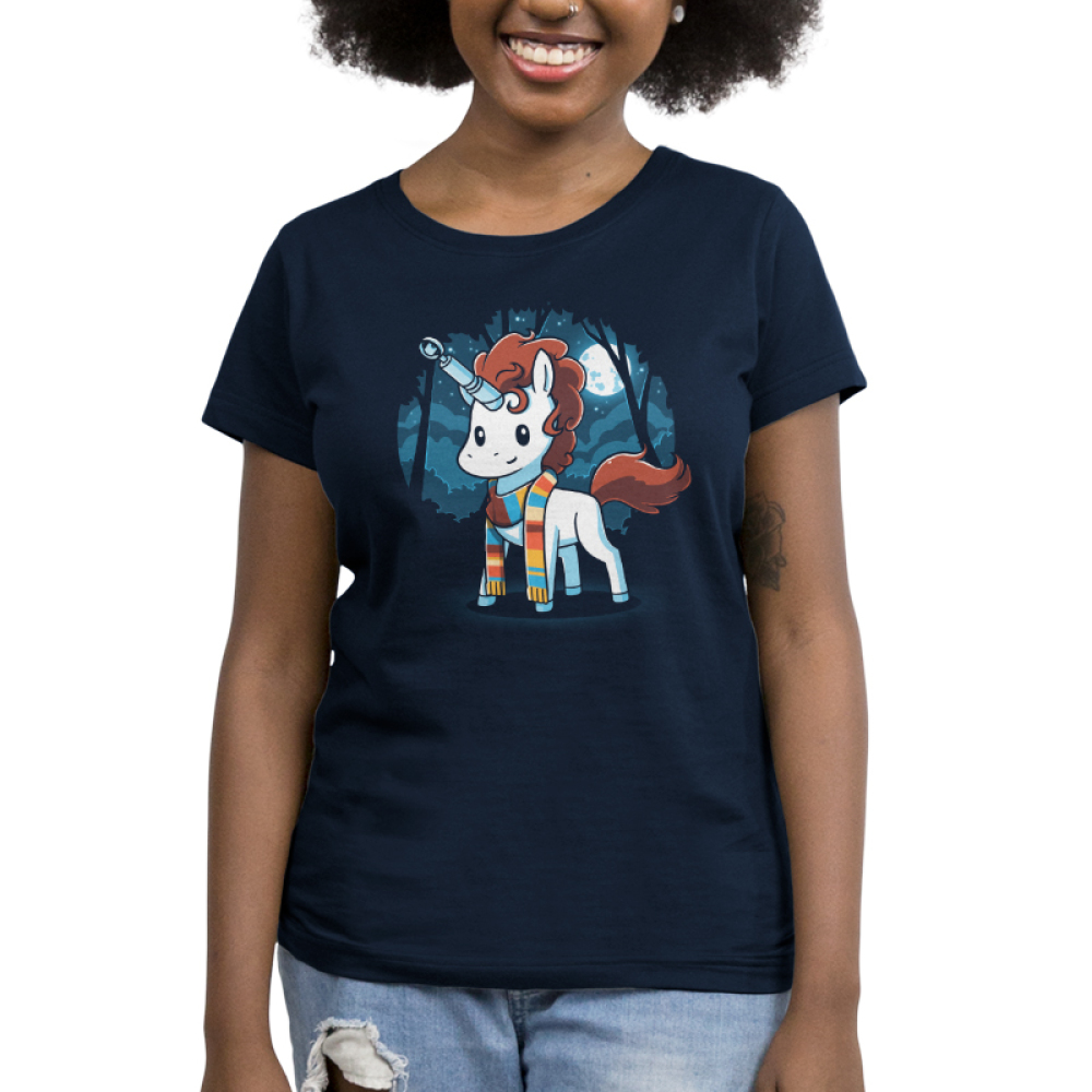 The Fourth Unicorn Women's t-shirt model TeeTurtle navy t-shirt featuring a white unicorn with brown hair with a multicolored scarf on with a sonic screwdriver and its horn and a dark forest and full moon background behind him