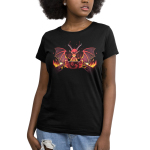 Dragon Master Women's t-shirt model TeeTurtle black t-shirt featuring a red dragon with its wings up and long horns looking angry and focused with a gamee board in front of him and flames on either side of the game table he is sitting at