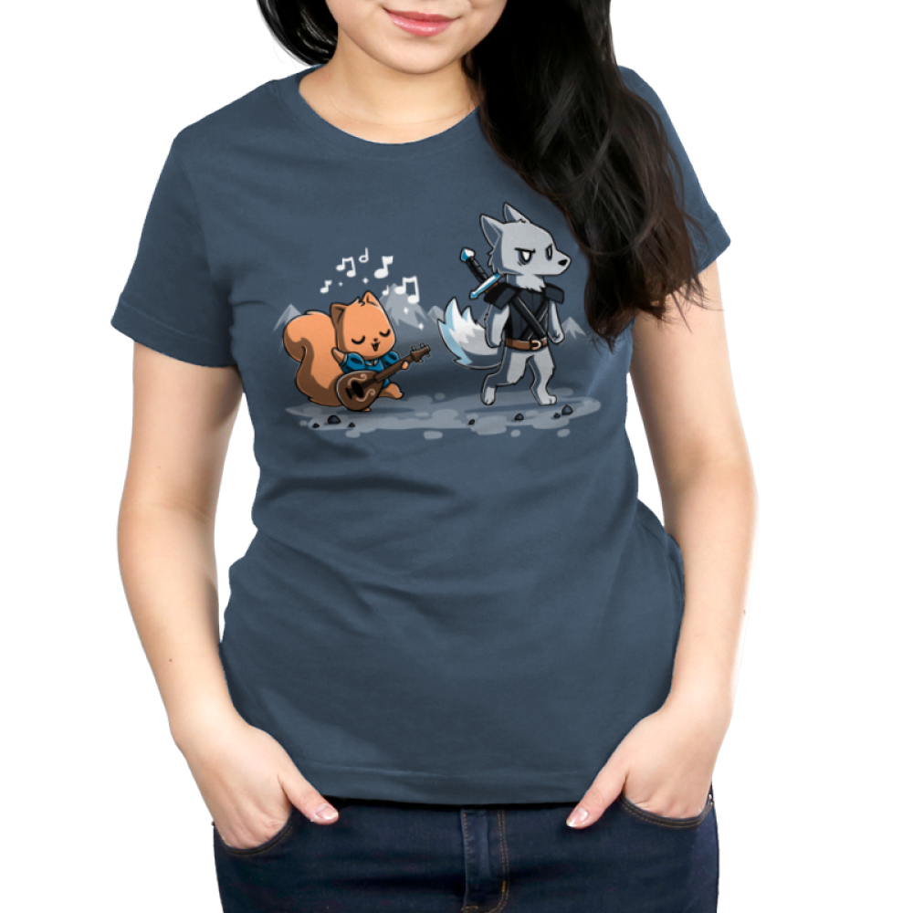 Ballad of the Bard Women's t-shirt model TeeTurtle denim blue t-shirt featuring a squirrel with a guitar singing with musical notes around him following behind an annoyed looking wolf with a sword on his back with mountains in the background behind them