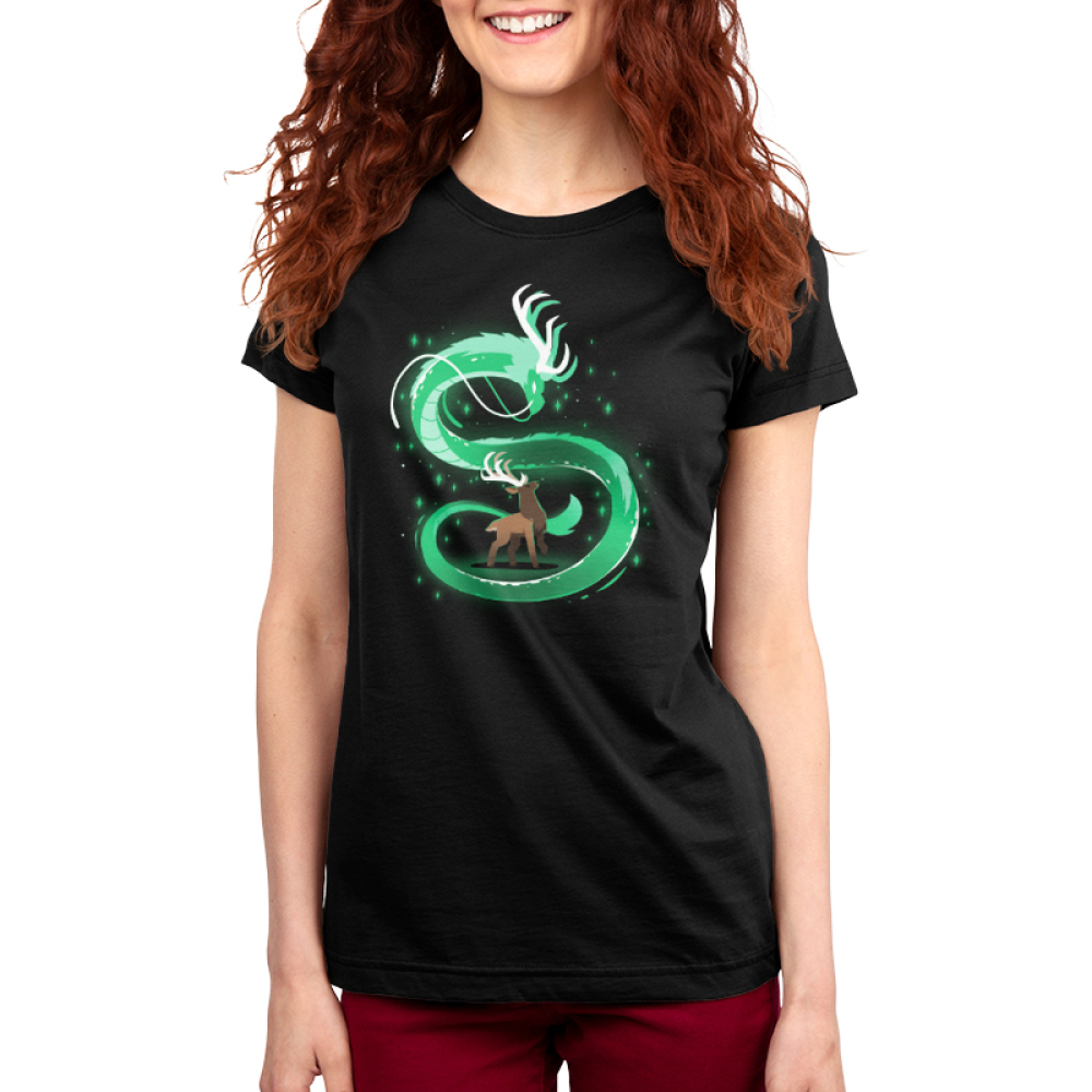 Spirit of the Woods Women's t-shirt model TeeTurtle black t-shirt featuring a buck looking up at a green dragon swirling all around him with green stars/sparkles