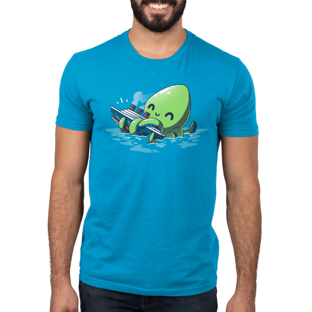 Release the Kraken Men's t-shirt model TeeTurtle cobalt blue t-shirt featuring a big green smiling octopus in blue water holding onto a boat with its tentacles