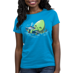 Release the Kraken Women's t-shirt model TeeTurtle cobalt blue t-shirt featuring a big green smiling octopus in blue water holding onto a boat with its tentacles
