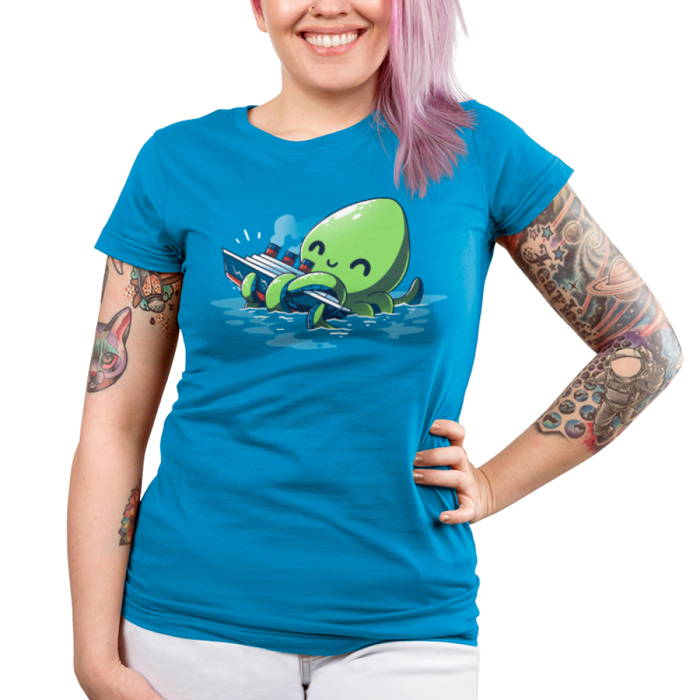 Release the Kraken Junior's t-shirt model TeeTurtle cobalt blue t-shirt featuring a big green smiling octopus in blue water holding onto a boat with its tentacles