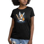 Prepare for Battle Women's t-shirt model TeeTurtle black t-shirt featuring a white focused looking bunny holding a gold sword, and tabletop dice shaped shield, with a gold helmet on with triangle dice down the middle of it