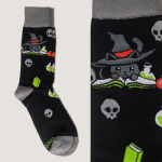 Spellbound Sock TeeTurtle socks featuring a gray cat with a witches hat on leaning over an open book with skulls and books on the socks