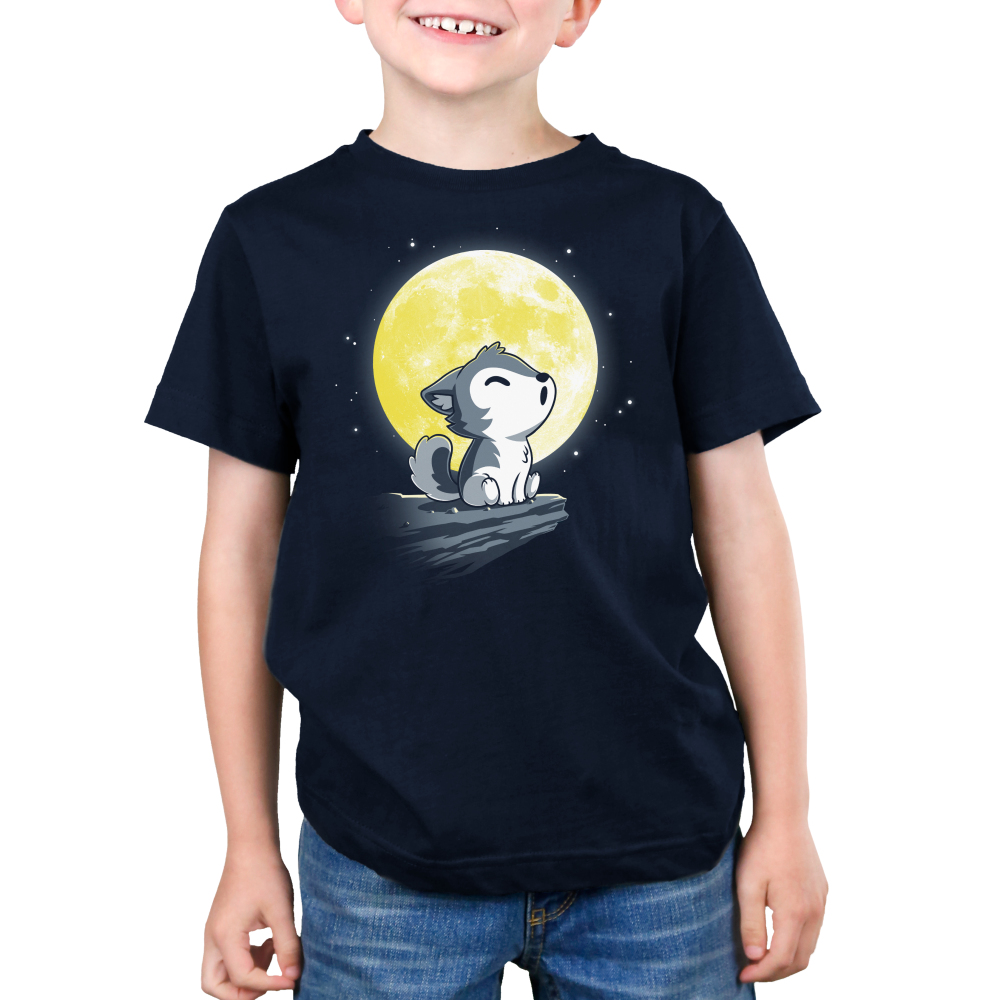 Lil' Werewolf Kid's t-shirt model TeeTurtle navy t-shirt featuring a little wolf pup howling on a rock ledge in front of a big full yellow moon