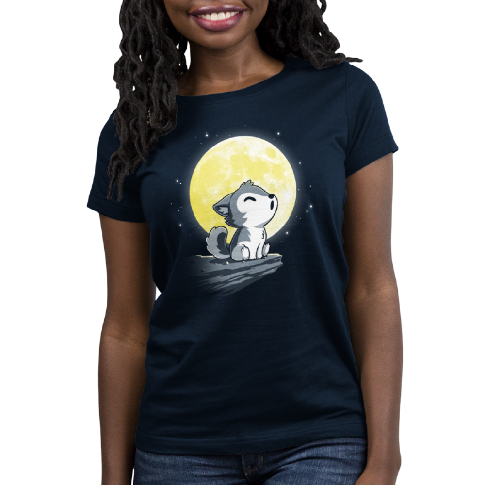 Lil' Werewolf Women's t-shirt model TeeTurtle navy t-shirt featuring a little wolf pup howling on a rock ledge in front of a big full yellow moon
