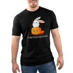What's on the Inside (Glow) Men's t-shirt model TeeTurtle black t-shirt featuring a cute white bunny popping out of a jack-o-lantern