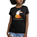 What's on the Inside (Glow) Women's t-shirt model TeeTurtle black t-shirt featuring a cute white bunny popping out of a jack-o-lantern