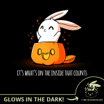 What's on the Inside (Glow) t-shirt TeeTurtle black t-shirt featuring a cute white bunny popping out of a jack-o-lantern