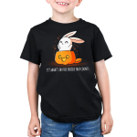 What's on the Inside (Glow) Kid's t-shirt model TeeTurtle black t-shirt featuring a cute white bunny popping out of a jack-o-lantern