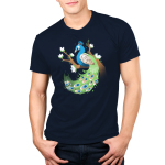 Proud Peacock Men's t-shirt model TeeTurtle navy t-shirt featuring a blue and green peacock perched on a tree branch that has white flowers stemming off the branches
