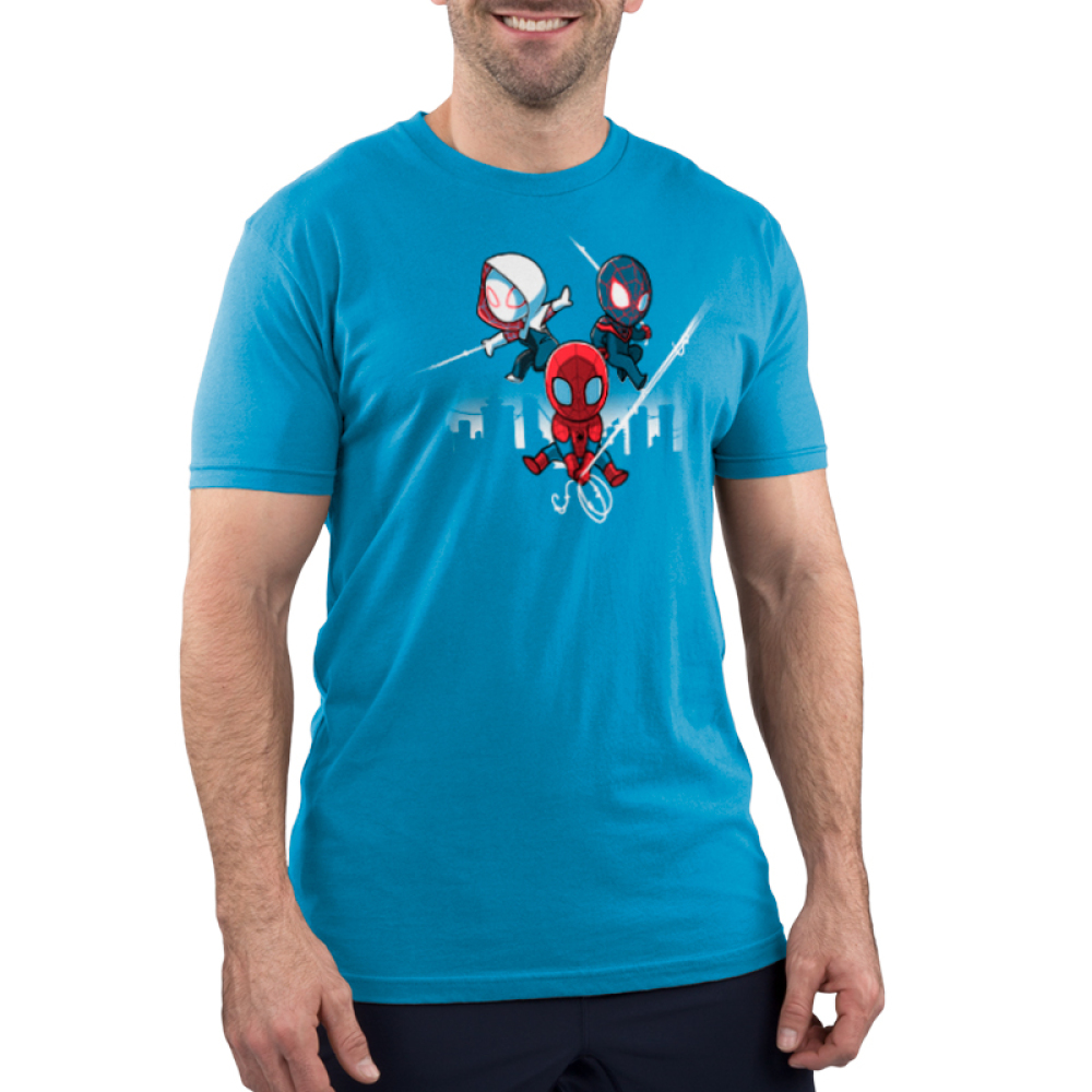 Spider People Men's t-shirt model officially licensed cobalt blue Marvel t-shirt featuring Spider Man in his red suit holding onto a spider web in the middle, and him in his white suit on the left and black suit on the right