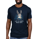 Life is Short. Read Fast. Men's t-shirt model TeeTurtle navy t-shirt featuring a bunny sitting up against some pillows reading a book with a flashlight with stars behind him