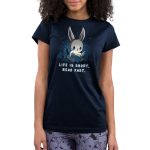 Life is Short. Read Fast. Junior's t-shirt model TeeTurtle navy t-shirt featuring a bunny sitting up against some pillows reading a book with a flashlight with stars behind him