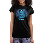 Celestial Dragon (Glow) Junior's t-shirt model TeeTurtle black t-shirt featuring a big black twisty dragon in the night sky above a lake surrounded by trees and mountains with constellations all around him