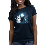 Star-Crossed Lovers Women's t-shirt model TeeTurtle navy t-shirt featuring a white cat with a gold tiara all wide eyed looking at a black cat with big white glasses on holding a rose while they are outside in front of a full moon and stars