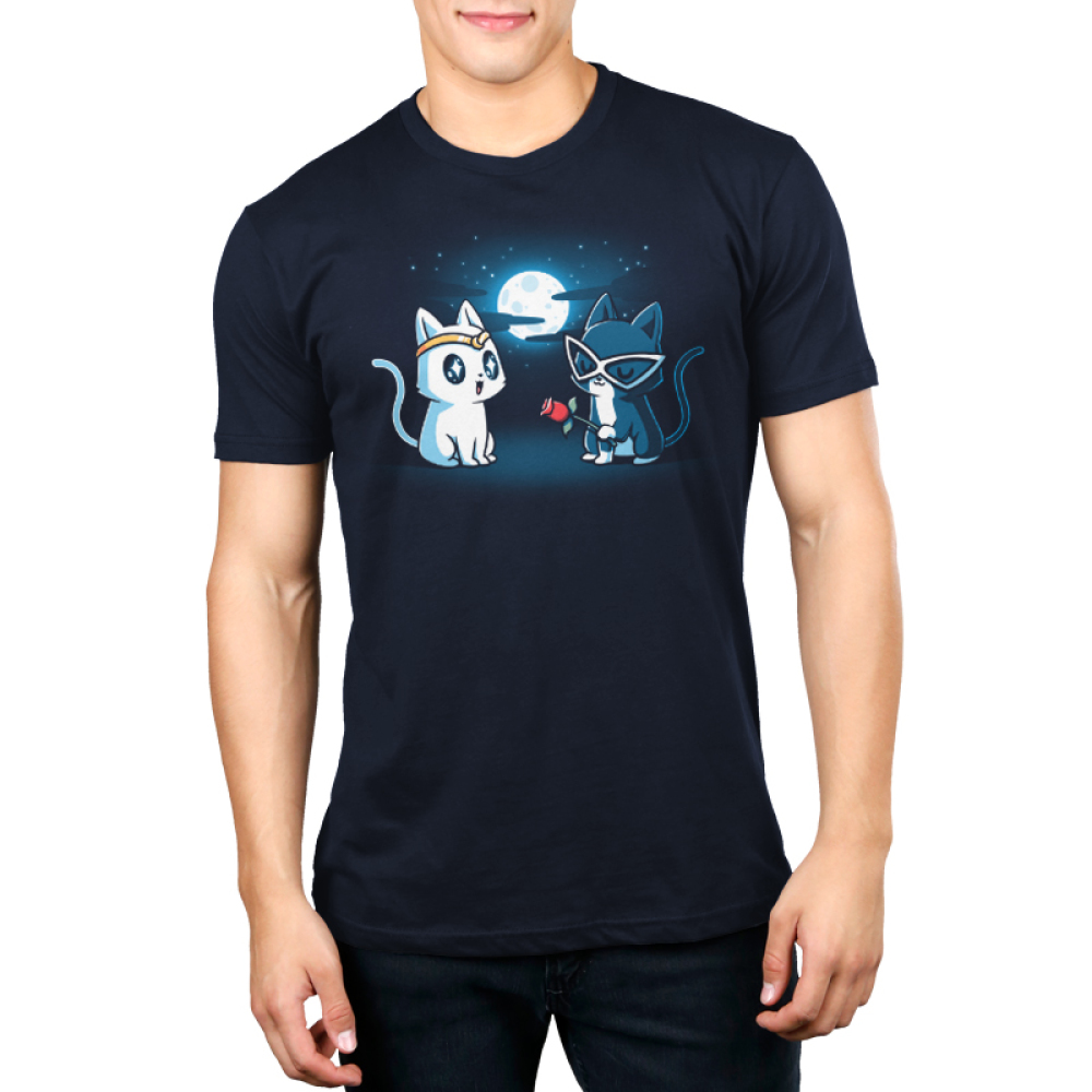 Star-Crossed Lovers Men's t-shirt model TeeTurtle navy t-shirt featuring a white cat with a gold tiara all wide eyed looking at a black cat with big white glasses on holding a rose while they are outside in front of a full moon and stars