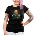 Potion Master Junior's t-shirt model TeeTurtle black t-shirt featuring an otter with big round glasses holding up a potion flask with blue liquid and bubbles with an open book, scrolls, a feather pen, and a bowl with blue potion and a candle underneath it all in front of him