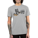 Go Ahead, Bake My Day Men's t-shirt model TeeTurtle silver t-shirt featuring an angry looking gray cat with flour all over its face holding a dirty whisk with a rolling pin and bowl next to him