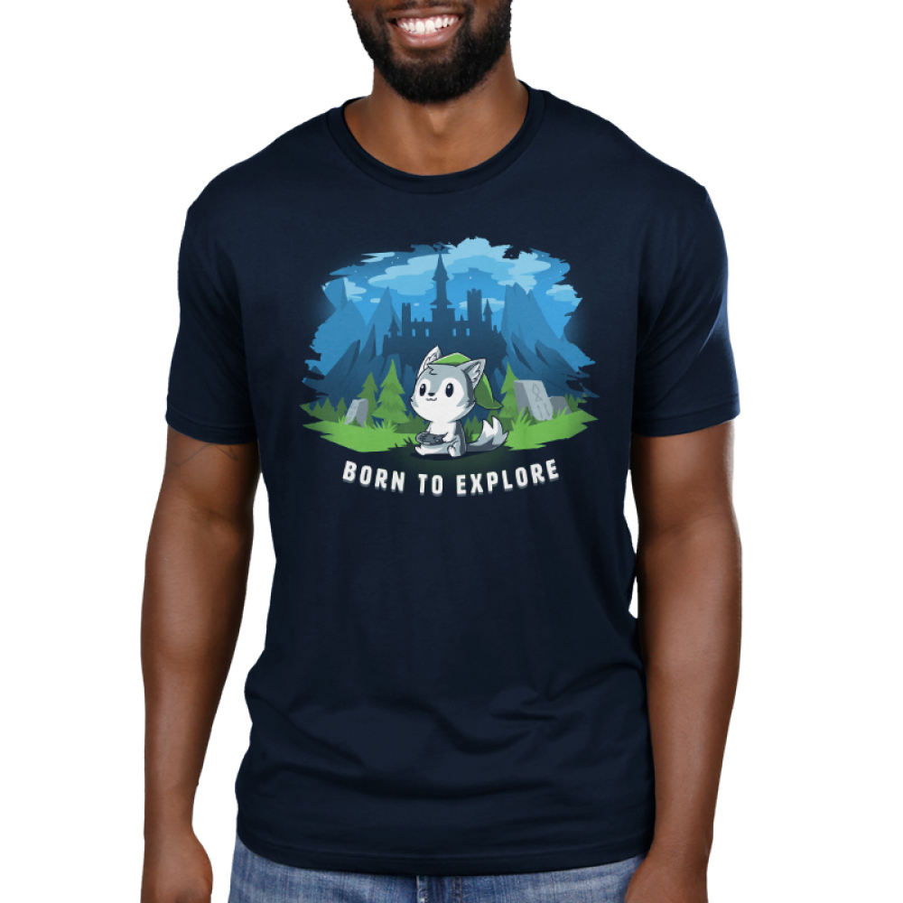 Born to Explore Men's t-shirt model TeeTurtle navy t-shirt featuring a little wolf holding a video game remote with a green slouchy hat on with a fantasy landscape behind him - a castle, mountains, green grass