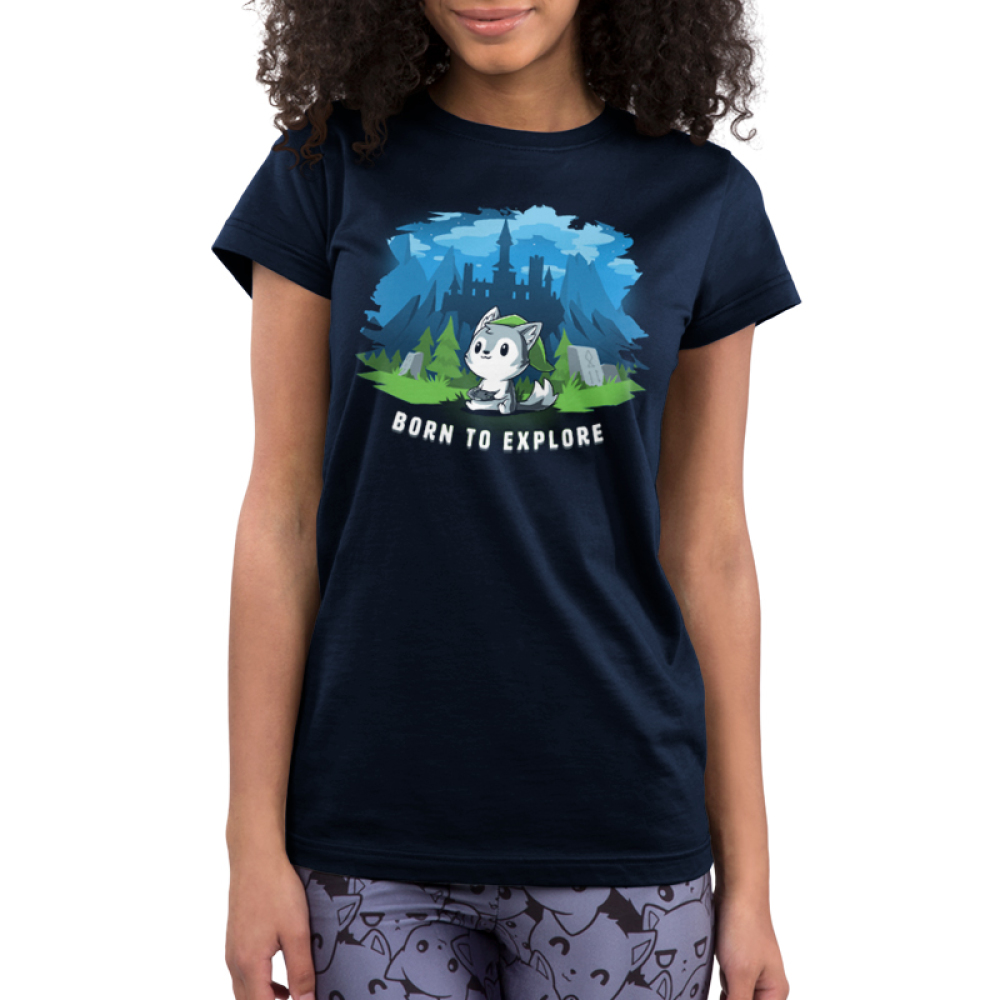 Born to Explore Junior's t-shirt model TeeTurtle navy t-shirt featuring a little wolf holding a video game remote with a green slouchy hat on with a fantasy landscape behind him - a castle, mountains, green grass