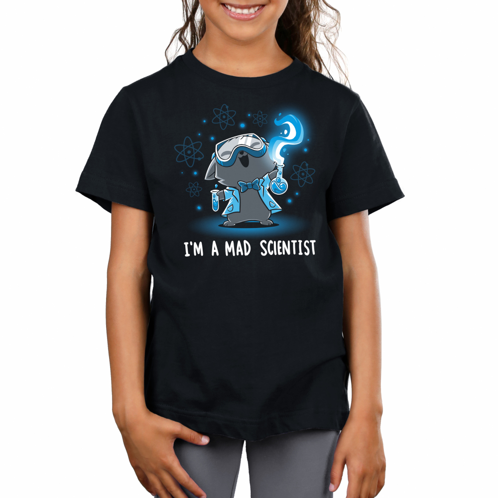 Mad Scientist Kid's t-shirt model TeeTurtle black t-shirt featuring a cat with its head back, mouth open smiling, and eyes squinted with science googles on, a lab coat and bow tie, and two flasks with green liquid in each hand