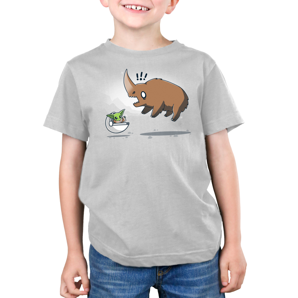 The Child vs. The Mudhorn Kid's t-shirt model officially licensed silver Star Wars t-shirt featuring the child in his little floating carrier waving at a Mudhorn which has jumped in the air and looks scared