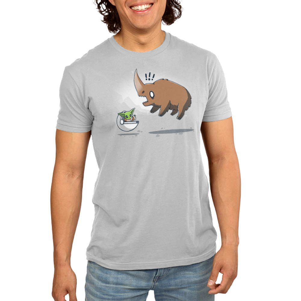 The Child vs. The Mudhorn Men's t-shirt model officially licensed silver Star Wars t-shirt featuring the child in his little floating carrier waving at a Mudhorn which has jumped in the air and looks scared