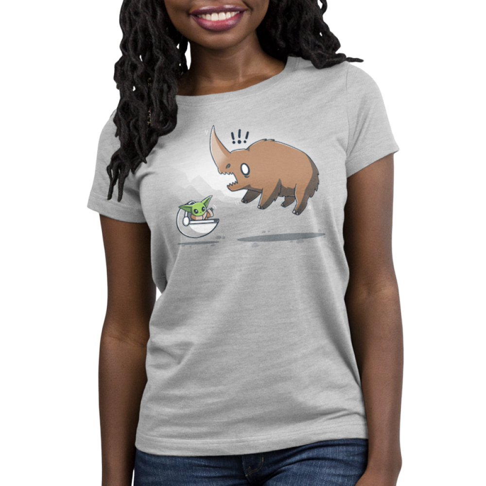 The Child vs. The Mudhorn Women's t-shirt model officially licensed silver Star Wars t-shirt featuring the child in his little floating carrier waving at a Mudhorn which has jumped in the air and looks scared